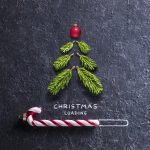 Christmas Card - Loading Concept - Tree And Candy Canes On Black Stone