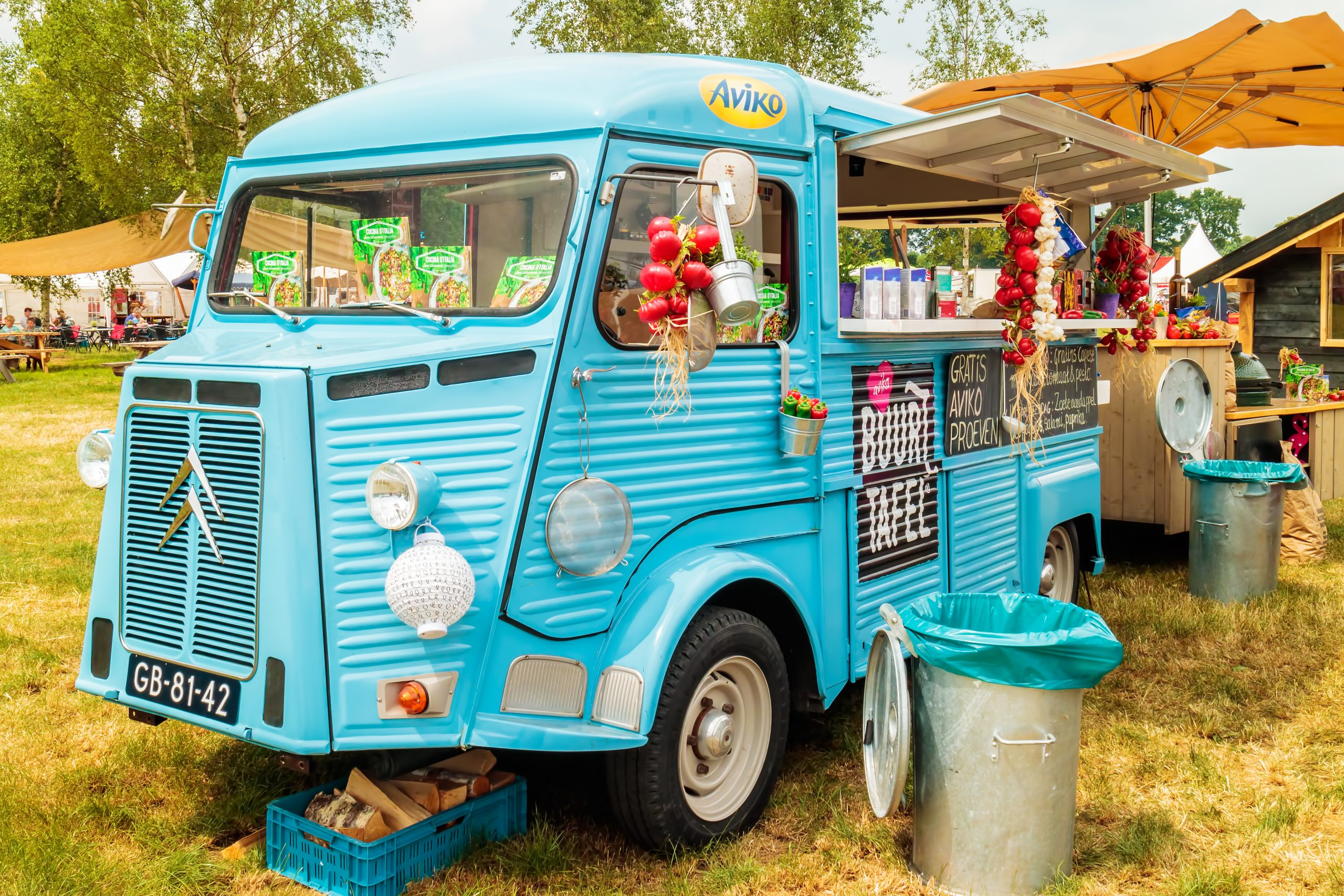 AALTEN, THE NETHERLANDS - JUNE 26, 2017: Vintage blue food truck on a country fair in Aalten, The Netherlands